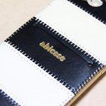 白黒ストライプ柄abicase アビケースは計算された幅の革をつなぐことでiPhoneケースを仕上げている / iPhone 6/6s [レビュー 35/40]